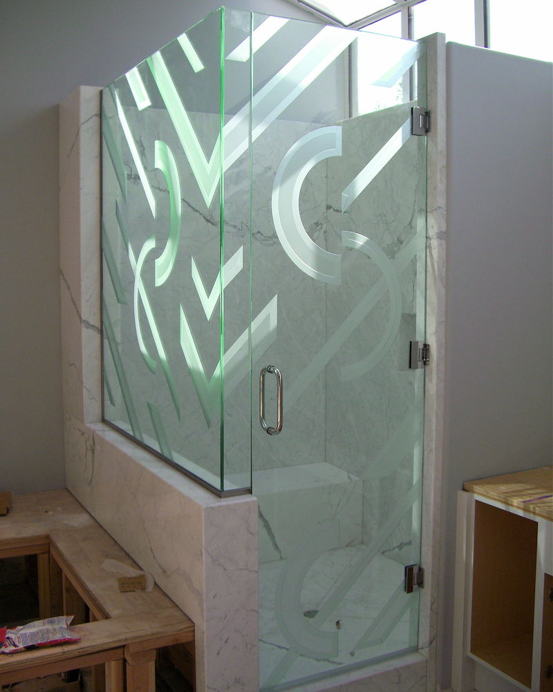 Decorative glass shower enclosure carved and etched glass half