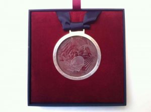 In Excellent Hands Glass Medallion