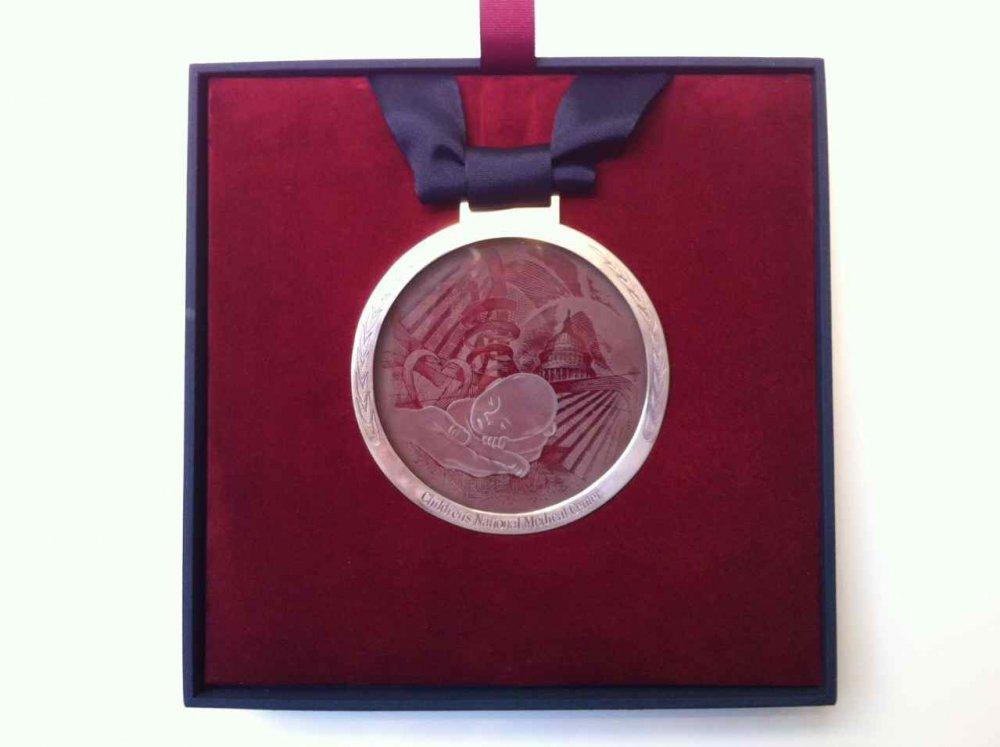 Glass Medallion In Excellent Hands Sans Soucie
