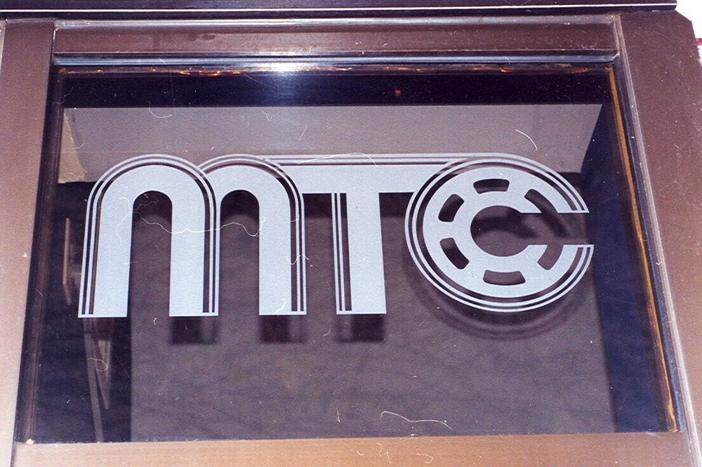Glass Signs Metropolitan Theatres Sans Soucie