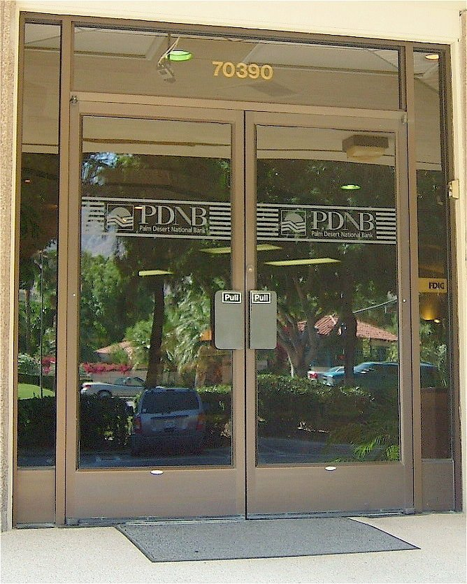 Entry Double Doors with Glass Etching Logo bank by Sans Soucie
