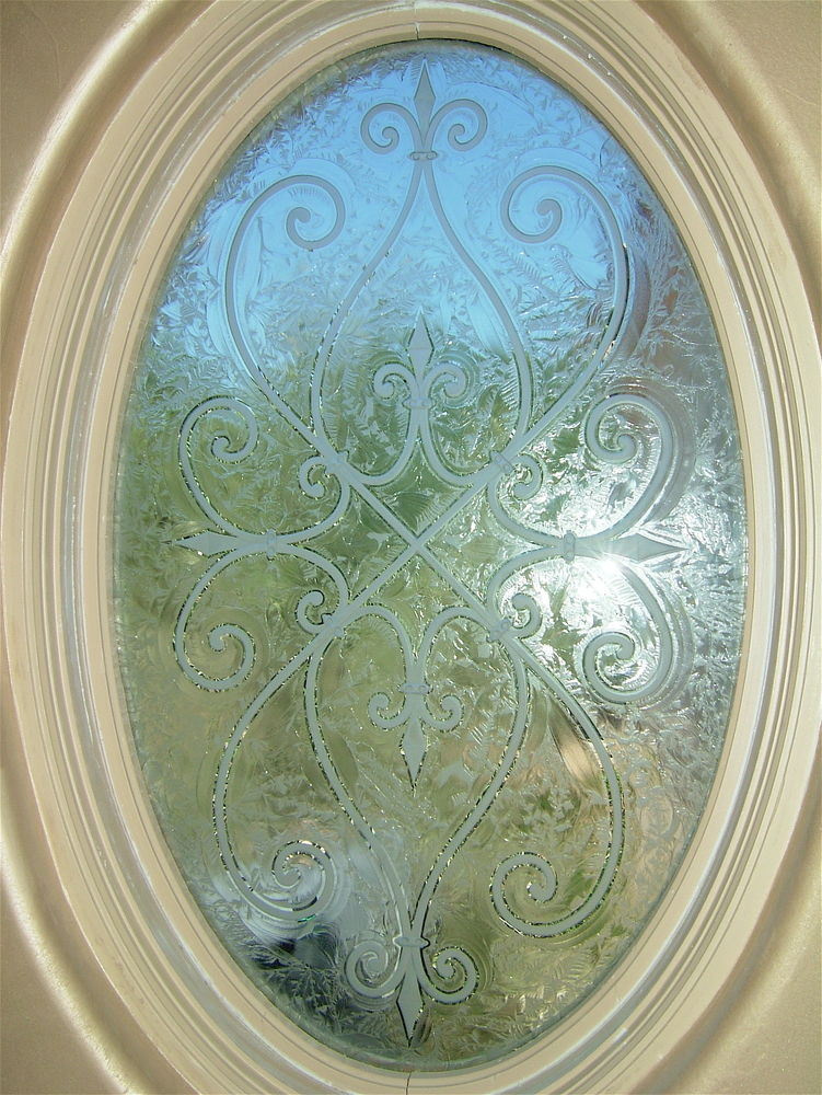 glass window etched glass Tuscan design iron bars cordoba oval sans soucie