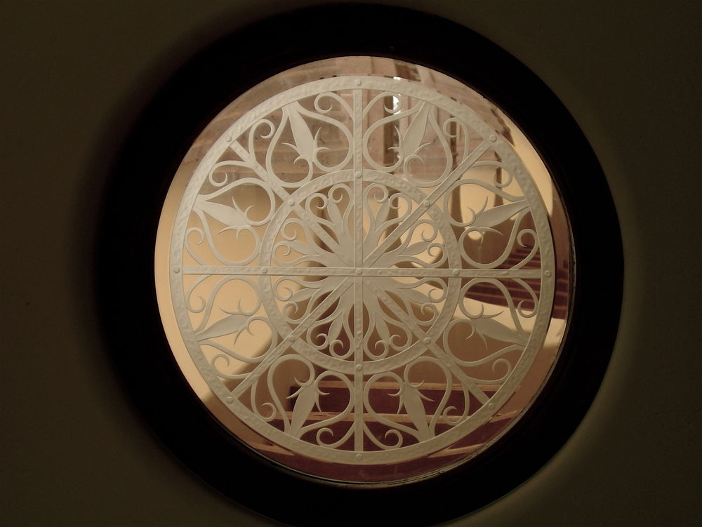 glass window etched glass Moroccan decor iron bars ornate ornamental round sans soucie