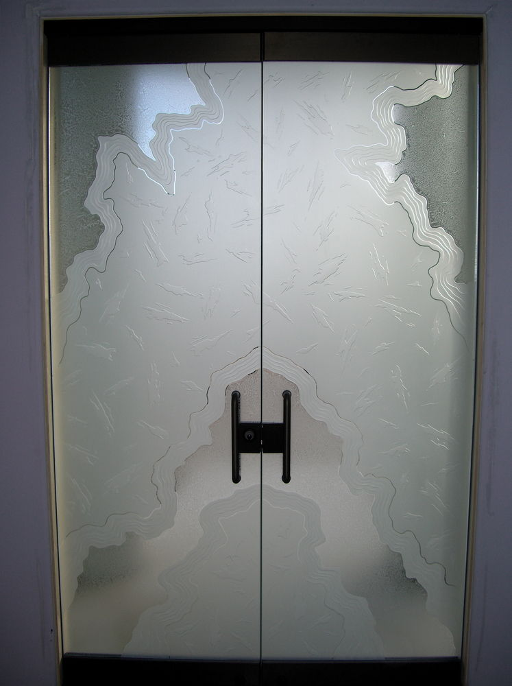 Frameless Glass Doors with Carved and Gluechipped Glass by Sans Soucie