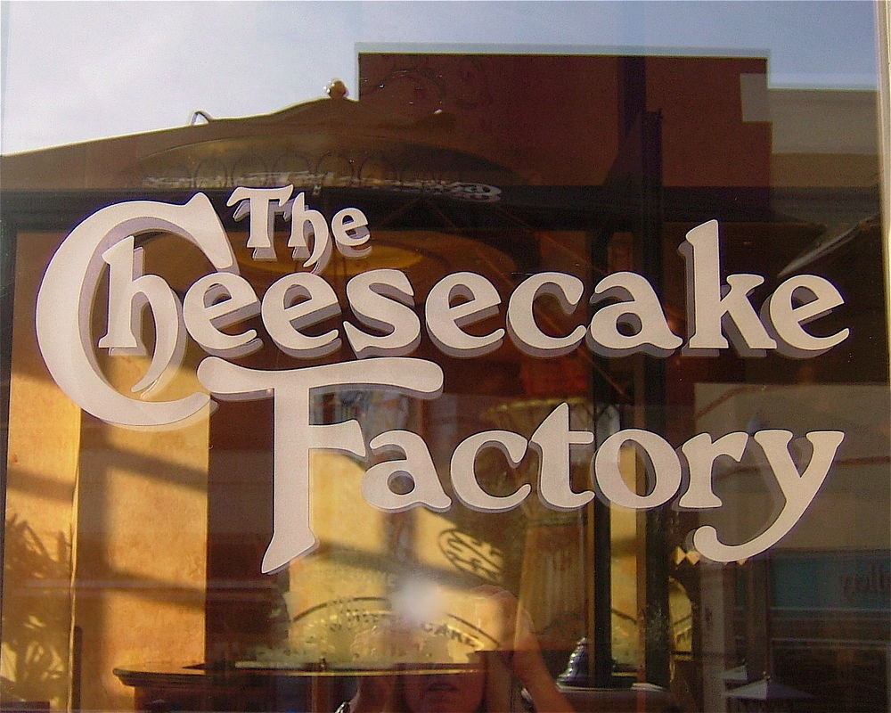 Cheesecake Factory Signs Sans Soucie