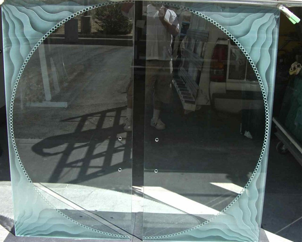 Frameless Glass Doors with Glass Carving by Sans Soucie