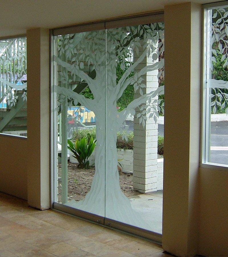 The tree of life frameless glass doors sans soucie for Frameless glass doors