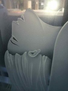 etched glass woman head tilted back art glass