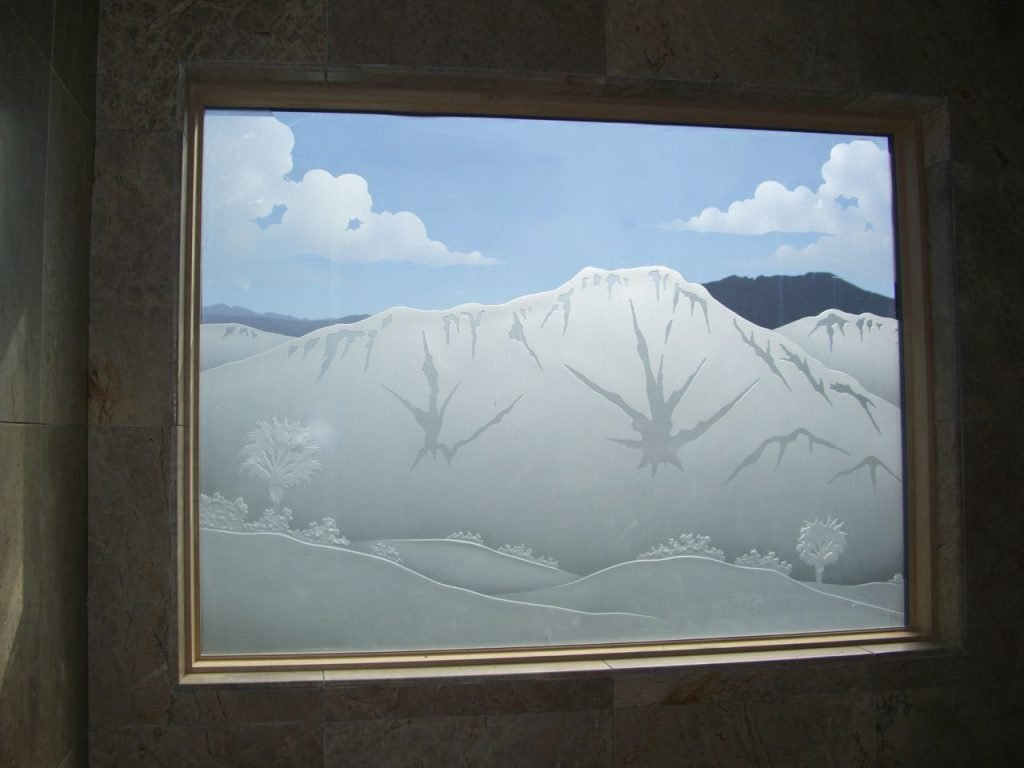 etched glass window desert mountains palm trees