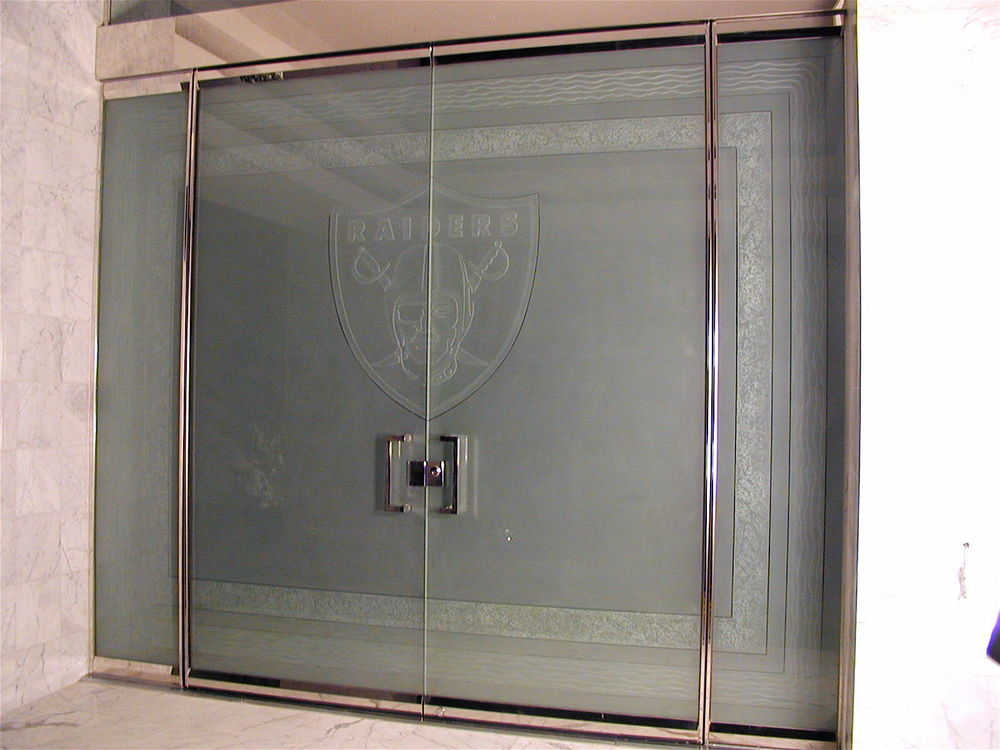 glass entry doors custom glass etching  raiders football logo etched glass