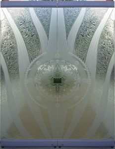 Frameless Doors with Gluechipped and Carved Glass gears by Sans Soucie