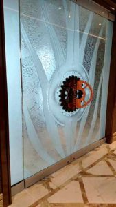 Entry Doors Frameless with Gluechipped and Carved Glass gears by Sans Soucie