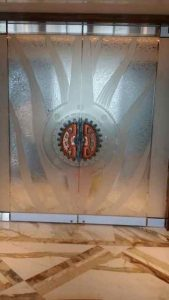 Sans Soucie Entry Doors Frameless with Carved and Gluechipped Glass gears