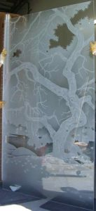 Sans Soucie Windows with Etched and Carved Glass Rustic