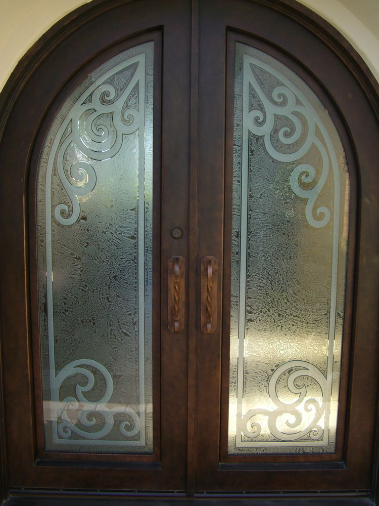 etched glass door carved wrought iron