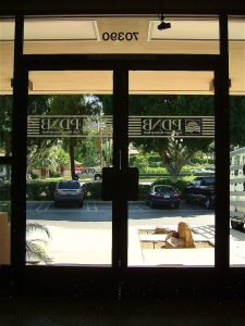 Sans Soucie Entry Double Doors with Glass Etching Logo bank