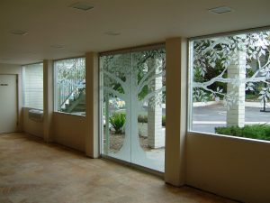 Sans Soucie Frameless Glass Doors with Carved Glass Trees