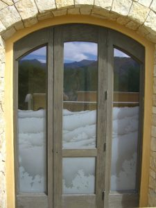 glass window frosted glass rustic style hills bushes desert views in the reserve ll sans soucie