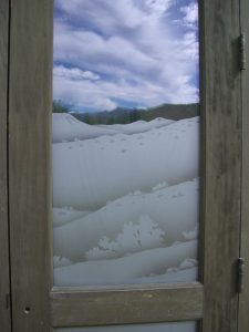 glass window etched glass rustic style mountains plants desert views in the reserve ll sans soucie