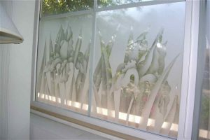 glass window frosted glass English country style flowery plants iris garden sans soucie