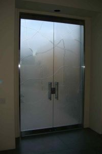 Sans Soucie Front Doors Frameless with Glass Etching and Carved