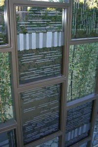 Sans Soucie Outdoor Metal and Glass Partition with Glass Carving Modern Pattern