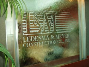 Glass Signs Painted and Carved Ledesma and Meyer Construction by Sans Soucie