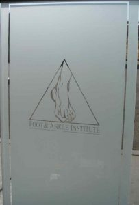 Sans Soucie Door Inserts with Etched Glass Logos Foot and Ankle Institute