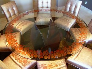 Sans Soucie Circles Pattern Carved and Painted Glass Orange on Round Table