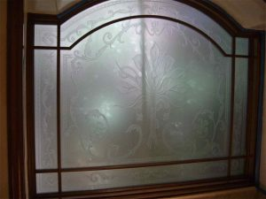 glass window frosted glass French style intricate patterns picturesque cala lillies sans soucie