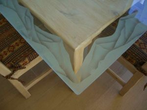 Sans Soucie Table Tops with Carved Glass Border mountains