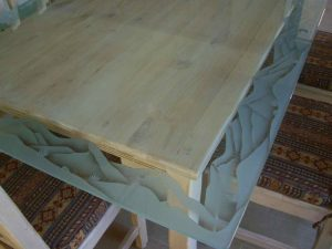 Sans Soucie Dining Tables with Glass Carving Border mountains