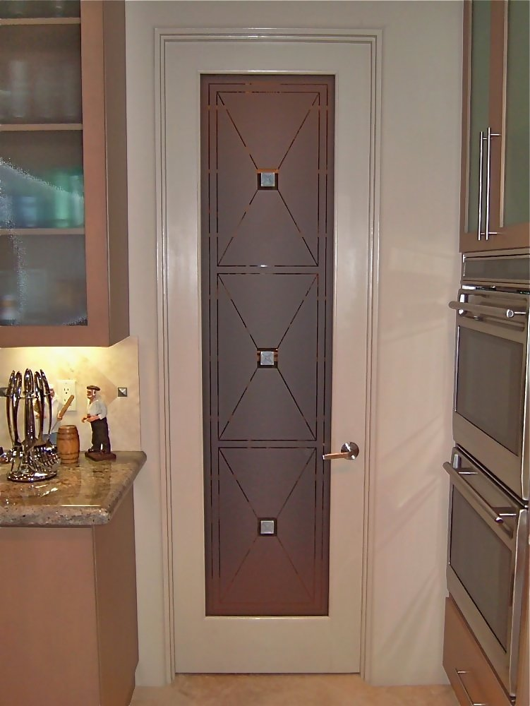 etched pantry door glass triangle squares, grommet, decorative glass, specialty carved art glass.