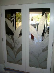 interior glass doors etched glass tropical decor bird of paradise