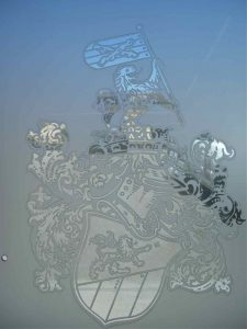Frameless Glass Doors Etched and Craved family crest by Sans Soucie
